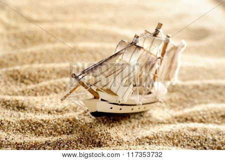 Wooden Sail Ship Toy Model In The Sea Sand Close-up