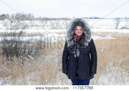 Woman Saunters Outdoors In Winter.