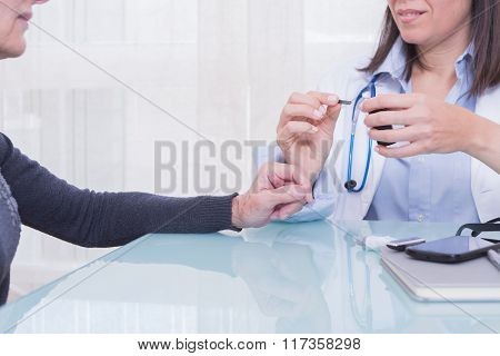 Doctor Showing Patient Diabetes Test Strips