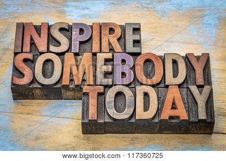 inspire somebody today - motivational text in vintage letterpress wood type