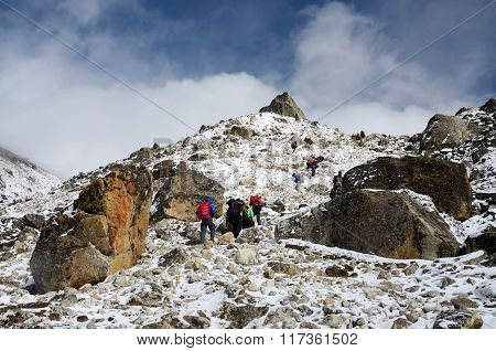 Group Of Hikers Climbing Mountain range on their way to Everest Base camp,Nepal