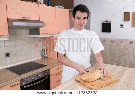 Man Cutting Bread