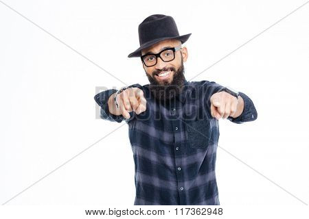 Smiling bearded young african american man in hat and glasses pointing in camera