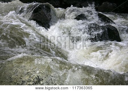 Mountain river rushing water flowing texture on Kola peninsula