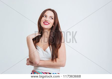 Laughing woman looking away isolated on a white background