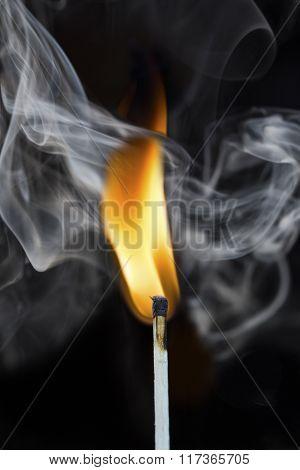 Burning Match With Smoke On Black