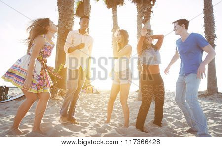 Group Of Friends Celebrating On The Beach In La