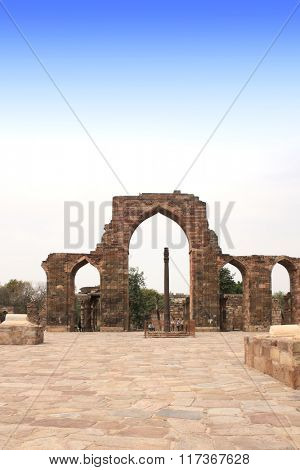 Iron Pillar and Qutab Minar Ruins in Delhi, India. UNESCO world heritage site