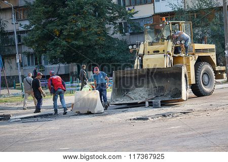 Kiev, Ukraine - September 21, 2015 : Construction Management Workers Work To Repair The Road Surface