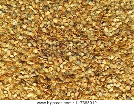 Bed of red chili seeds. food background.