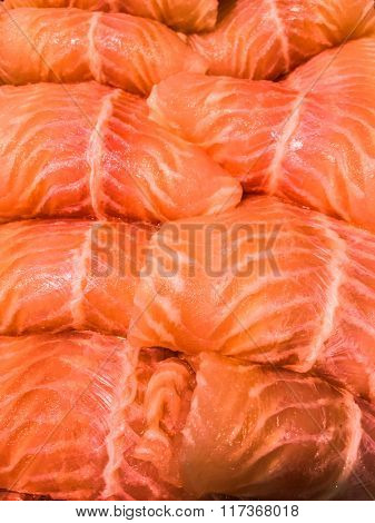 Raw and fresh fish fillet close up.