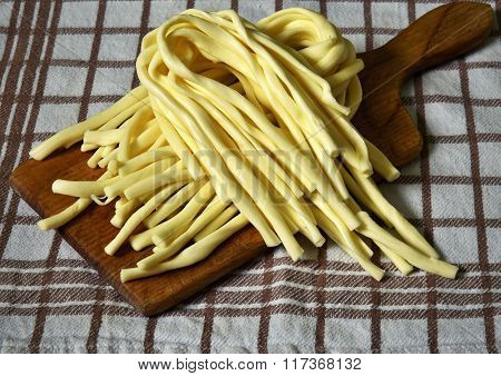 traditional cheese strand on a wooden kitchen board