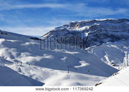 Ski Resort And Sunlight Rocks At Evening