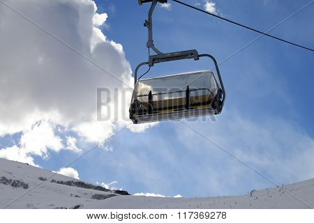 Chair-lift In Ski Resort At Sun Evening