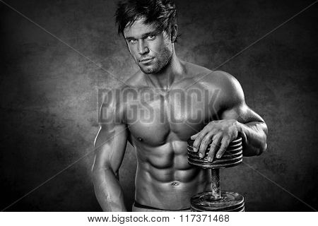 Young Muscular Sexy Man Standing In Front Of Wall