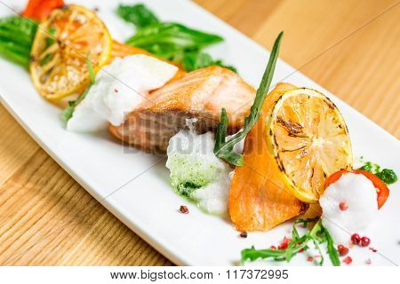 Salmon Steak With Grilled Vegetables, White Sauce And Lime