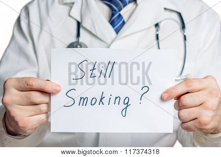 Doctor holds a clipboard with still smoking label