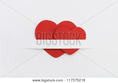 Two Red Paper Valentine`s Hearts.