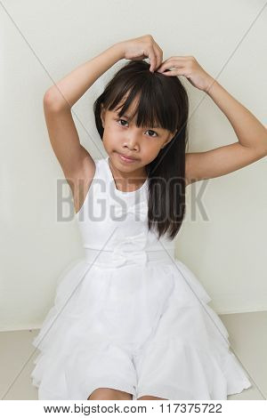 Beautiful Little Asian Girl  Isolated In White