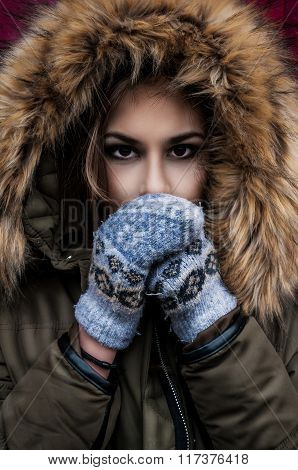 Girl In A Hood And Gloves