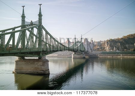 Famous Liberty Bridge of Budapest on an autumn day. Side view.