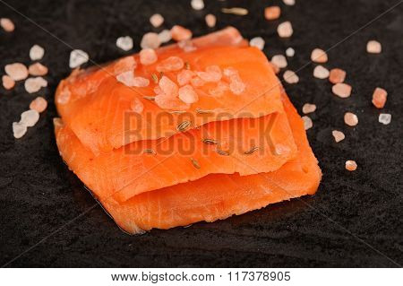 Wild Salmon Salted With Coarse Pink Himalayan Salt On Black Background