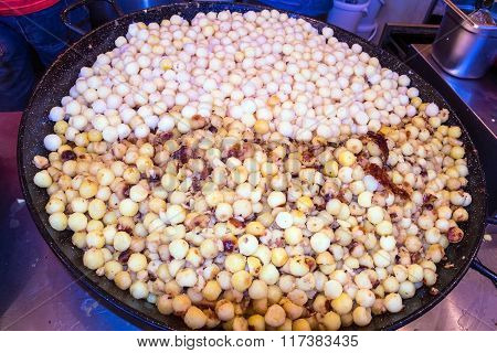 Fried Potatoes With Bacon - Traditional German Dish On Christmas Market
