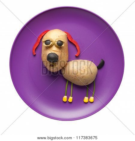 Funny Dog Made Of Vegetables On Purple Plate