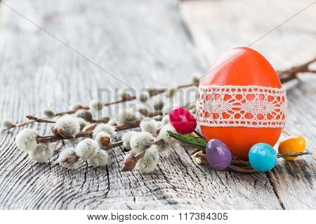 Red Easter Egg Decorated With Lace And Willow Branch On Wooden Background. Selective Focus, Copy Spa
