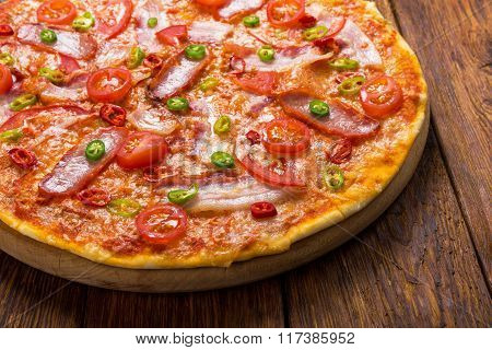 Delicious Pizza With Red And Green Hot Chili Peppers