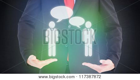 Businessman presenting your product with hands against black room