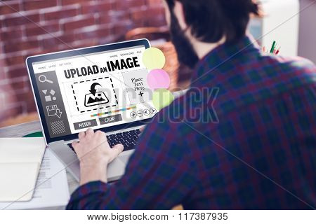 Designer interface against rear view of creative editor working on laptop
