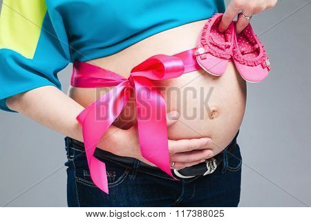 Pregnant Belly With Pink Ribbon.