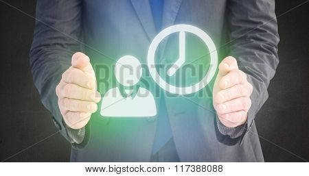Businessman standing with hands out against grey room