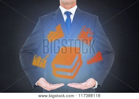 Businessman presenting against dark room