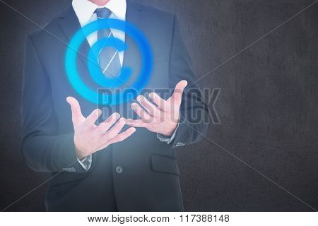 Businessman gesturing with his hands against room with wooden floor