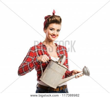 Woman with pin-up make-up and hairstyle holding metal watering c