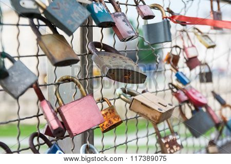Love Padlocks Hanging On Bridge