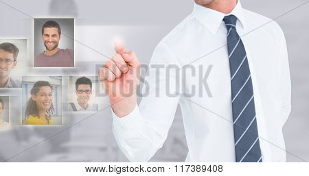 Businessman pointing with his finger against grey