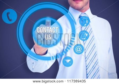 Businessman in shirt pointing with his finger against grey
