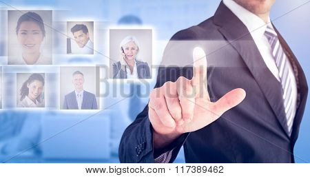 Businessman pointing with his finger against blue background