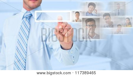 Businessman in shirt pointing with his finger against blue background