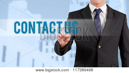 The word contact us and businessman in suit pointing finger against low angle view of city buildings