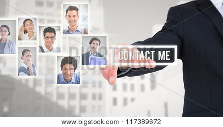 Businessman in suit pointing his finger against low angle view of city buildings
