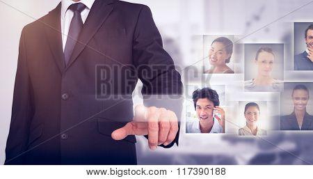 Businessman pointing against light grey
