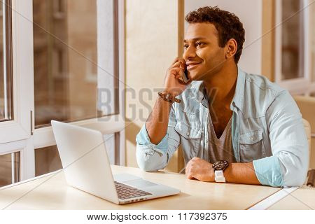 Young Mulatto Businessman Working