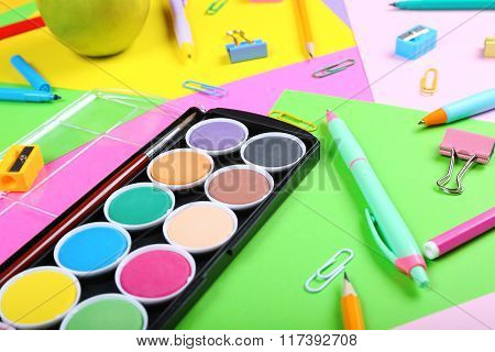 School Supplies On Colorful Papers Background, Close Up