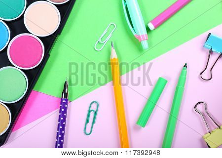 School Supplies On Colorful Papers Background