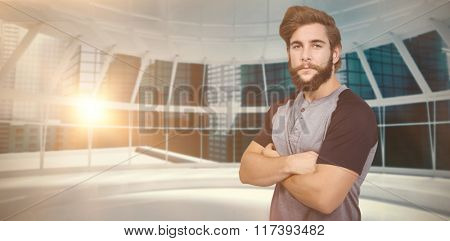 Portrait of confident hipster against modern room overlooking city