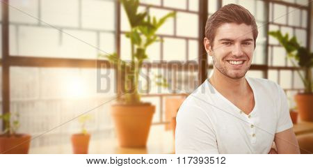 Handsome man against a line of green plants